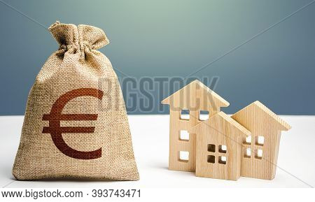 Euro Money Bag And Residential Buildings. Mortgage Loan. City Municipal Budget. Costs Of Service And