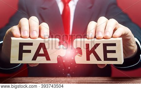 A Man Breaks A Fake Puzzle. Exposing Fake News And False Info. Debunking Myths. Investigation Of Dou