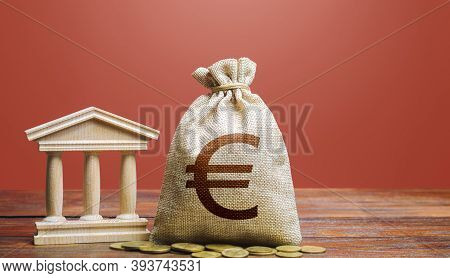 Euro Money Bag And Bank / Government Building. Tax Collection And Budgeting. State Debt. Gdp And Gnp