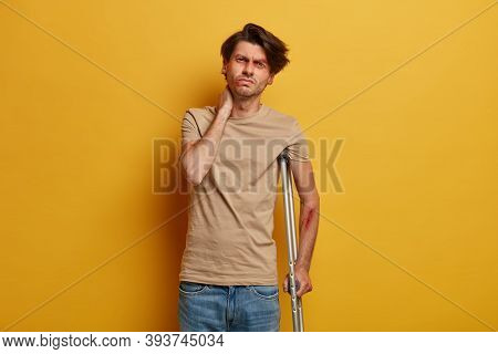 Disabled Frustrated Man Touches Neck, Has Problems With Spine And Bones After Serious Catastrophe, H