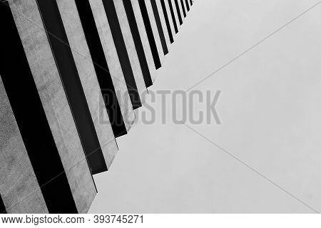 An Abstract View Looking At A Modern Concrete Building. Artistic View Of Exterior Architectural Desi