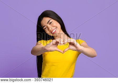 Cheerful Young Korean Woman Shaping Hands Like Heart, Showing Love Gesture, Romantic Asian Lady Expr