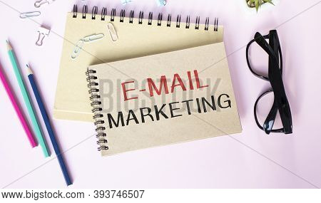 E-mail Marketing And Cup Of Coffee. E-mail Marketing Written On White Paper With Cup Of Coffee ,keyb