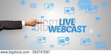 Close-Up of cropped hand pointing at LIVE WEBCAST inscription, social networking concept