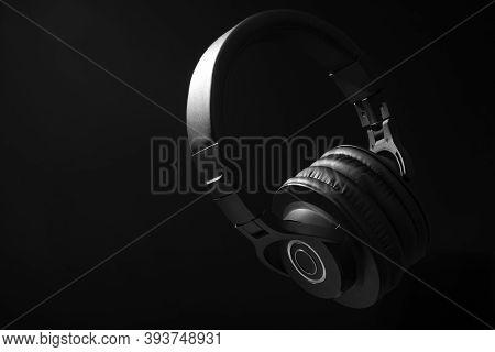 Black Professional Headphones On A Black Background. Musical Production. Sound Studio Equipment. Sou