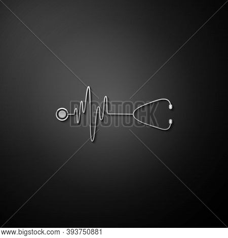 Silver Stethoscope With A Heart Beat Icon Isolated On Black Background. Medical Concept. Pulse Care