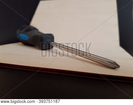 Screwdriver For Screwing And Unscrewing Fasteners With A Thread On A Black Isolated Background