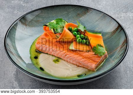 Italian Cuisine. Red Fish Salmon Steak, Beautiful Serving Of Cooked Fried Salmon Steak On A Ceramic
