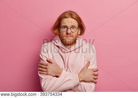 Upset Redhead European Man Crosses Arms Over Body, Tries To Warm Himeself, Hates Cold Season, Windy