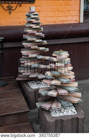 Eco Friendly Christmas Trees Of Pyramid Shape Made From Recycled Parquet Wood Boards. Alternative Ch