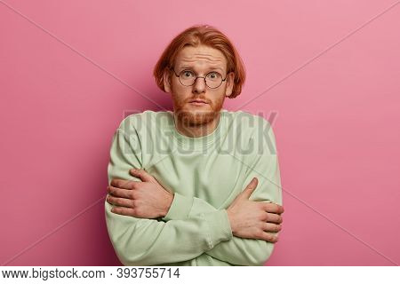 Oh No, Its Freezing And Cold. Worried Bearded Ginger Bearded Man Trembles From Low Temperature, Cros