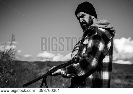 Hunter With Shotgun Gun On Hunt. Hunting Without Borders. Clothes For The Hunter. Close Up Portrait