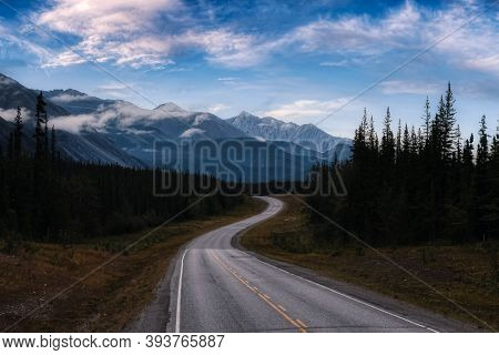 Beautiful View Of A Scenic Road, Alaska Hwy, In The Northern Rockies. Colorful Twilight Sky Artistic