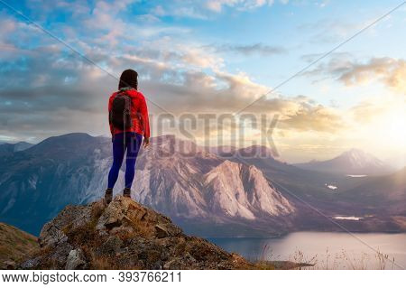 Adventurous Girl Hiking Up The Nares Mountain. Dramatic Colorful Sunrise Sky Art Render. Taken Near