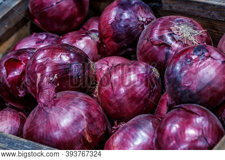 Red Onions In Plenty On Display At Local Farmer's Market, Big Fresh Red Onions Background.red Onions