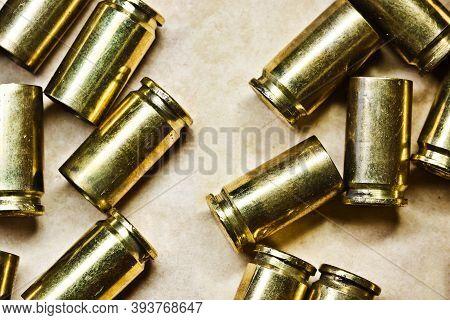 Bullet Shells Background. Metal Shiny 9mm Ammo Glock 19 Shells. Vintage Parchment Paper. Weapon Shoo