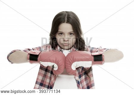 Full Concentration. Girl Concentrated Training Boxing Gloves. Child Concentrated Face With Sport Glo
