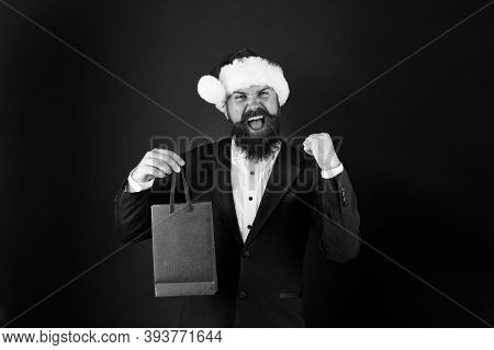 Just In Time For Boxing Day. Happy Manager Hold Paperbag With Winner Gesture. Bearded Man Celebrate