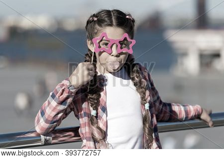 Getting Ready For Party. Small Naughty Girl Having Fun. Fashionable Glasses For Celebration. Stylish