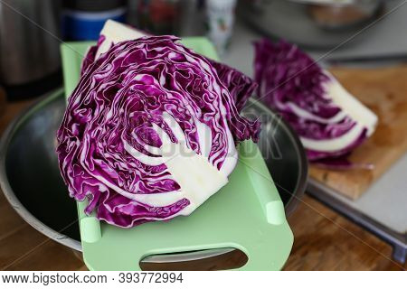 Red cabbage in kitchen ready for slicing