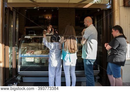 Novi Sad, Serbia - June 11, 2017: Ice Cream Parlour Selling Italian Gelato To Children And Men In A
