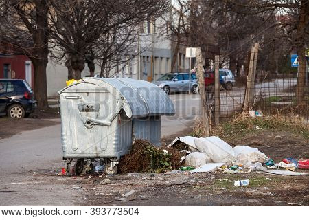 Belgrade, Serbia - February 2, 2020: Garbage Bins And Containers Full, Overflowing, With Bags Fallin