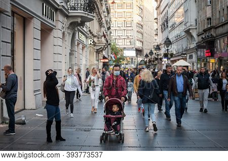 Belgrade, Serbia - October 10, 2020: Asian Family, A Father And His Son, Boy, In A Stroller, Walking