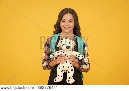 Little Schoolgirl With Toy And Backpack. Happy Childhood. Education Concept. Beginning Of Academic Y