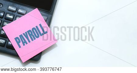 Payroll Word Written On Calculator. Business And Financial Concept