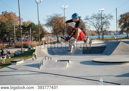 Detroit, Michigan / Usa - November 8 -2020: Skaters And Bikers Practice Tricks At An Outdoor Skate P