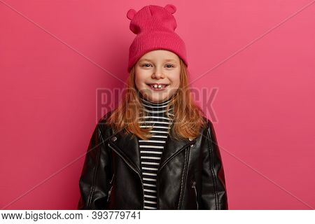 Stylish Positive Redhead Girl Smiles Broadly, Has Missing Teeth, Dressed In Fashionable Leather Jack