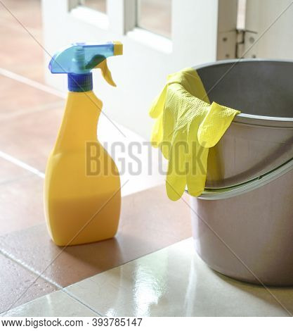 Cleaning Spray Gun With Hand Gloves And Water Pail. Tools For Cleaning And Disinfect,