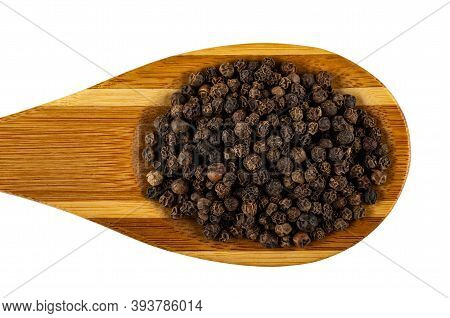Bamboo Spoon With Peppercorn Isolated On White Background. Top View