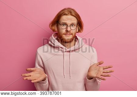 Perplexed Unaware Man With Ginger Hair, Spreads Palms, Feels Confused And Indecisive, Cant Help, Fin