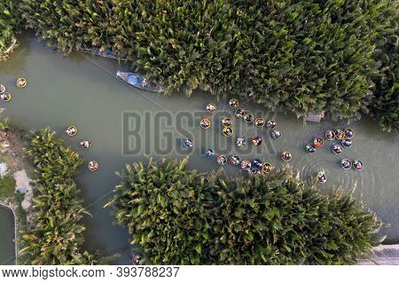 Aerial view, tourists in basket boats tour at the coconut water ( mangrove palm ) forest in Cam Thanh village, Hoi An, Quang Nam, Vietnam