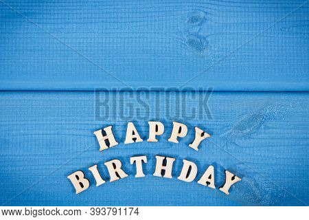 Inscription Happy Birthday On Blue Boards. Surprise For Birthday Occasion. Place For Text Or Inscrip