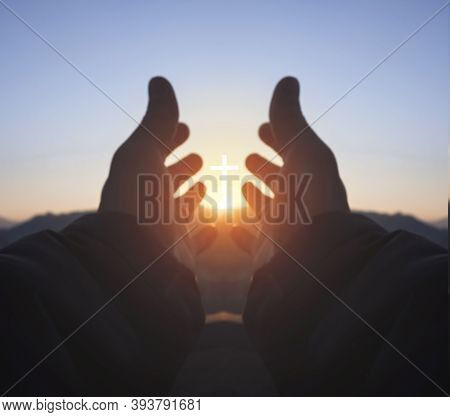 Religious Concept: Hands Palm Praying To Cross In The Sky