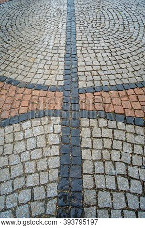 Traditional Color Stone Wet Pavement In Perspective. Abstract Background Of Old Cobblestone Pavement