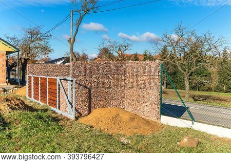 Construction Of A Family House. Stone Fence. In The Morning On The Construction Site. Gabion Wall Ca