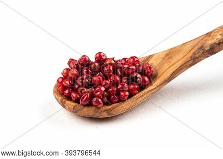 Isolated Wooden Spoon Of Red Peppercorns On The White Background