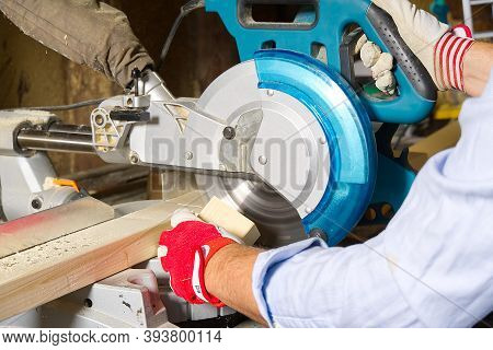 Carpenter Work With Circular Saw For Cutting Wood Bar, The Man Sawed Bars, Construction And Home Ren