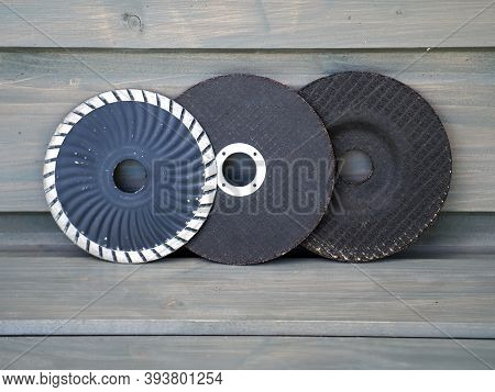 Cutting Discs For Angle Grinder. Cutting Discs On Gray Background. Construction Tools.