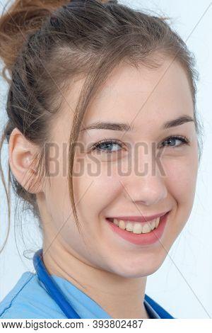 Portrait Of Young Nurse In A Blue Uniform