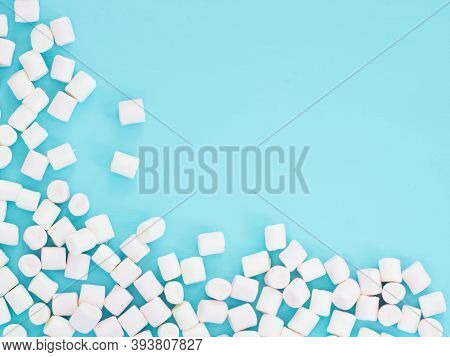 Marshmallows On Blue Background With Copyspace. Flat Lay Or Top View. Sweet Ackground Or Texture Wit