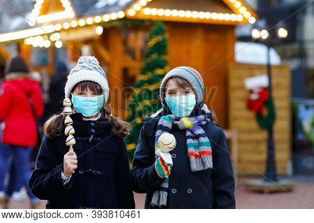 Little Cute Kid Girl And Boy On Traditional German Christmas Market. Children, Siblings And Best Fri