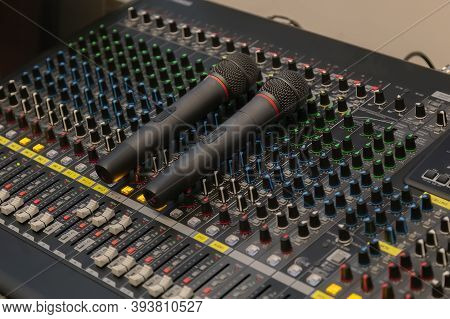 Microphone Placed On The Sound Mixer With Botton Sound Adjust. Sound And Microphone Tuner In The Con