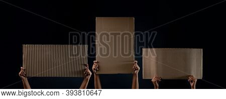 Protest , Mob Or Expression Concept. Group Of People Raised A Blank Corrugated Paper. Speech Templat
