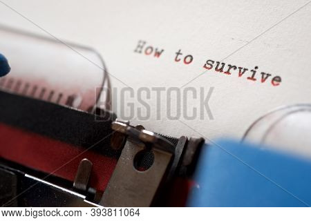 How to survive phrase written with a typewriter.
