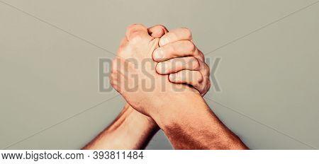 Arms Wrestling. Friendly Handshake, Friends Greeting, Teamwork, Friendship. Handshake, Arms, Friends