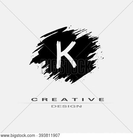 Letter K Logo With Brush Stroke And Splatter Elements. Handwritten Brush Stroke Letter K Logo Design